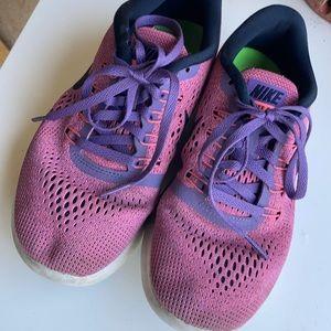 Nike Free RN Sneakers.